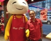 man smiling with hap chan mascot