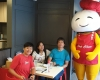customers smiling with hap chan mascot