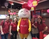 group of hap chan staff smiling with hap chan mascot